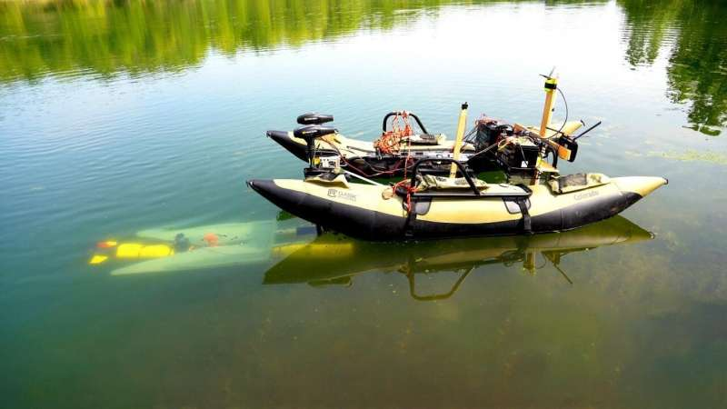 Underwater robots to autonomously dock mid-mission to recharge and transfer data