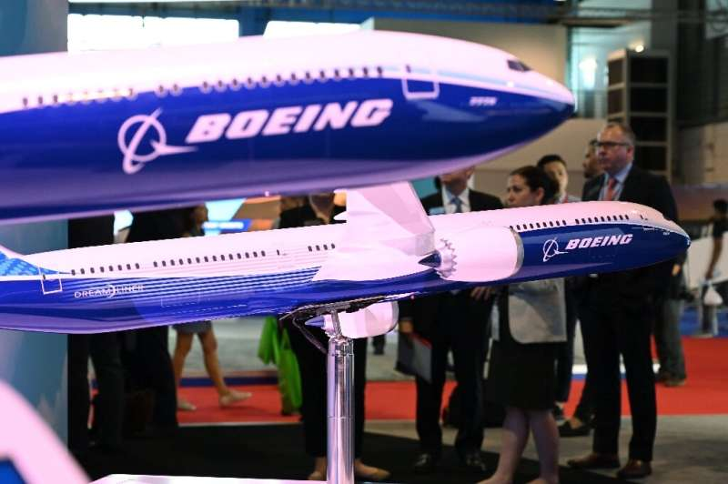 Visitors look at Boeing 787 and 777 models on display at the Singapore Airshow