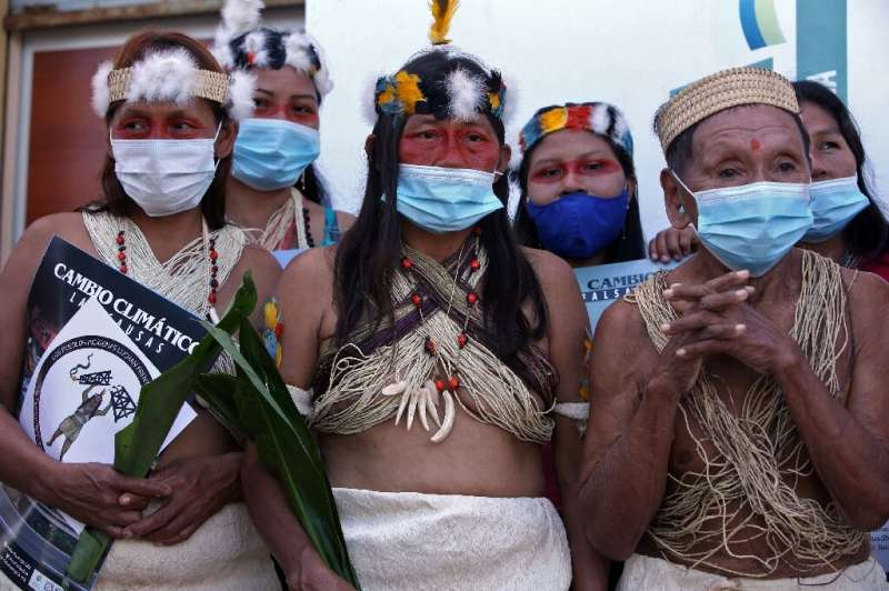 Waorani indigenous women pictured after filing a climate change lawsuit against Chinese oil company PetroOriental in El Coca, Or