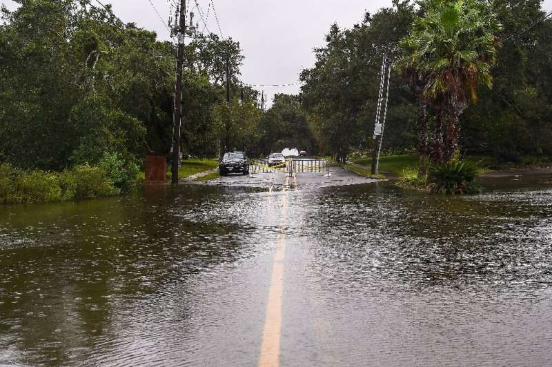 Water floods a road in Mississippi hours before Sally made landfall
