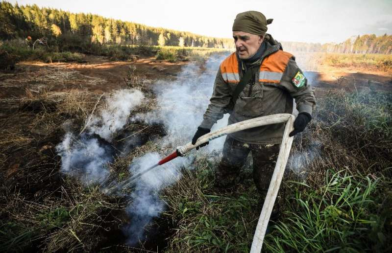 """Water-resistant, underground peatland blazes in Russia's Arctic circle are """"climate bombs"""", environmental activists sa"""