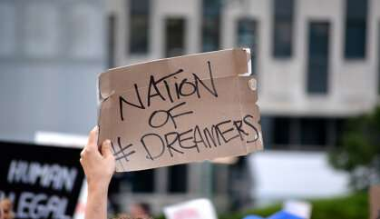 Why do white Americans support both strict immigration policies and dream act?