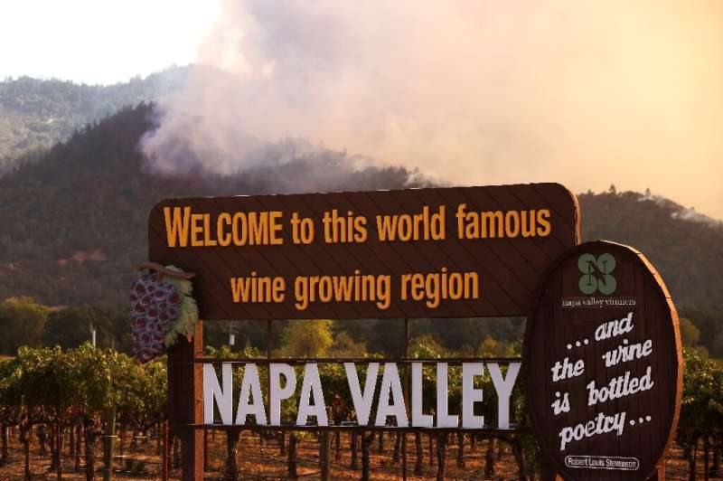 Wildfire rips through the world-famous Napa Valley, with smoke rising from the fast-moving Glass Fire on hills on September 27,