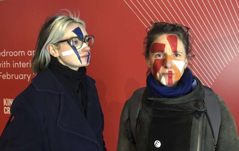 With painted faces, artists fight facial recognition tech