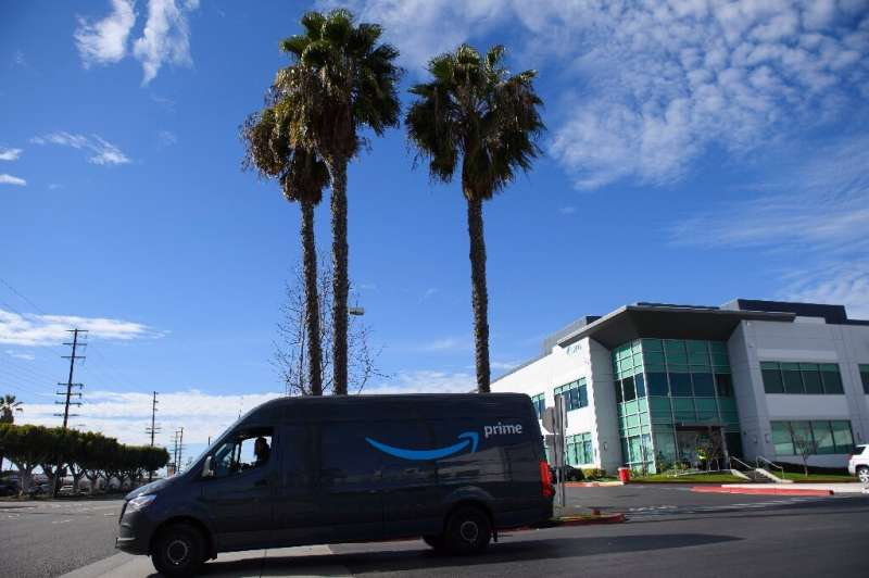 An Amazon. delivery driver departs a distribution facility in Hawthorne, California. The e-commerce giant said it was installing