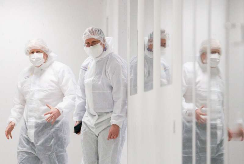 Britain's Prime Minister Boris Johnson visits an AstraZeneca facility in England