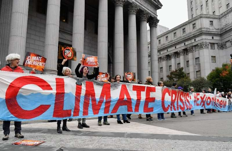 Climate protesters outside New York court in October 2019 at the start of Exxon Mobil's trial