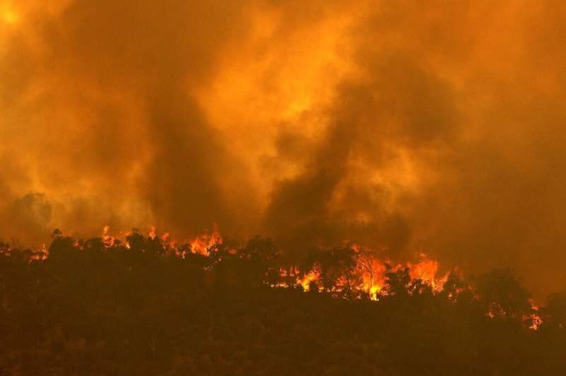 Firefighters are battling the out-of-control bushfire on the city's eastern fringes, where several properties are ablaze