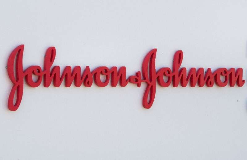 In this file photo taken on August 28, 2019 an entry sign to the Johnson & Johnson campus shows their logo in Irvine, Califo