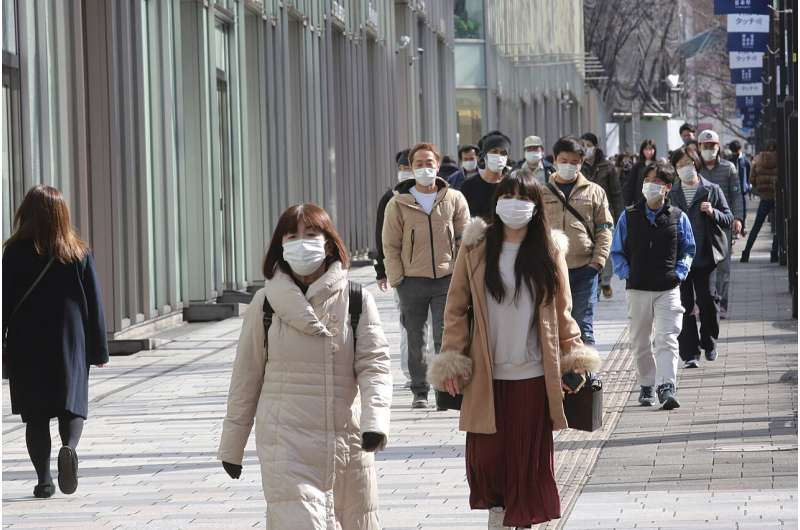 Japan extends emergency amid vaccine, Olympic uncertainty