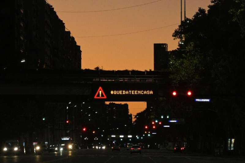This 2020 photo shows an electric sign in Buenos Aires telling people to stay home, as the city grapples with the coronavirus