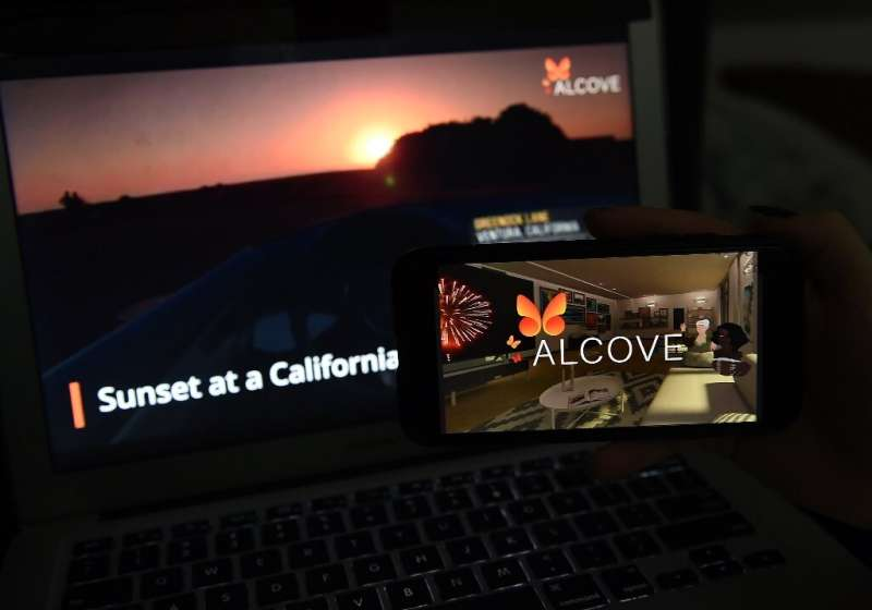 This illustration picture shows a virtual road trip on a computer and the travel application logo from Alcove VR displayed on a