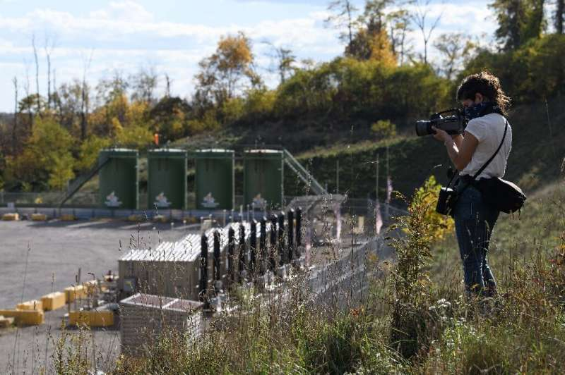 Environmental activist Leann Leiter uses an infrared camera to look for invisible emissions from the Mad Dog 2020 fracking site