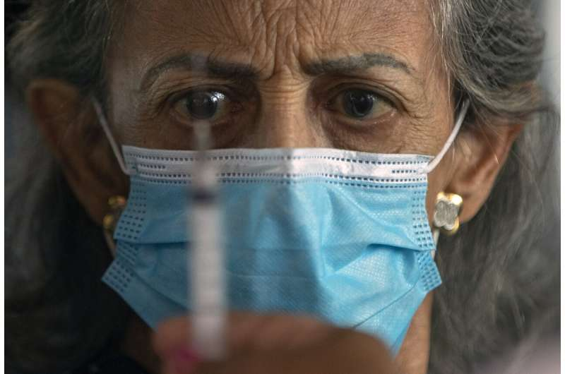 Brazil hospitals buckle in absence of national virus plan