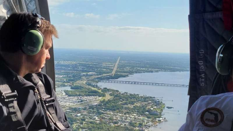 Florida Governor Ron DeSantis conducting a helicopter tour of the affected area Sunday