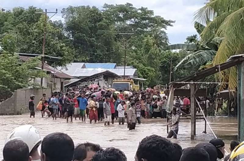 Rescuers hampered by damaged roads, more rain in Indonesia