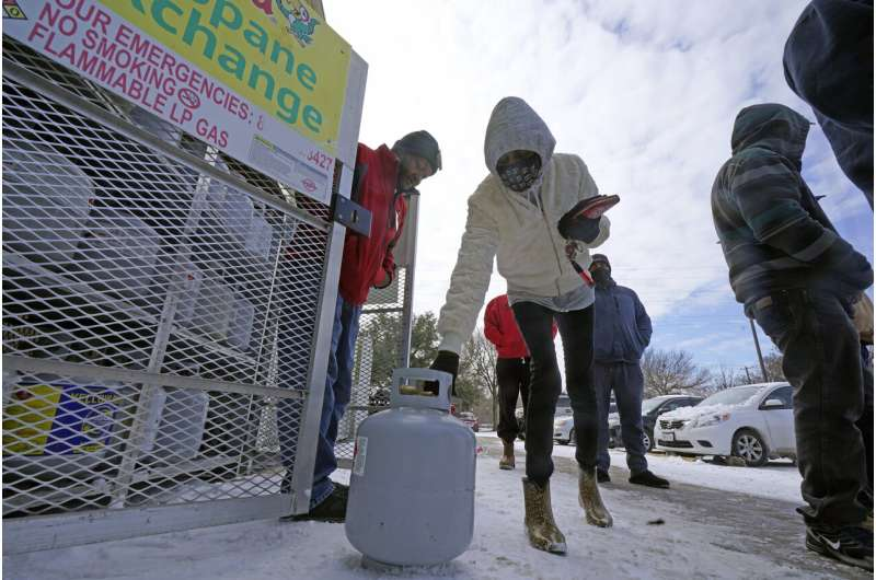 Millions endure record cold without power; at least 14 dead