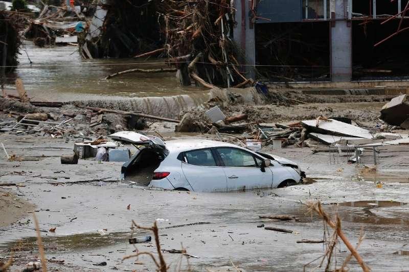 A car being carried away in Kastamonu, Turkey, after deadly flash floods swept across several Black Sea regions