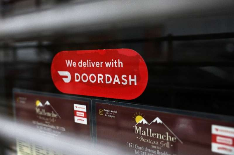 A Doordash sticker on the window at Mallenche Mexican Grill in the Flatbush neighborhood of Brooklyn on December 04, 2020 in New
