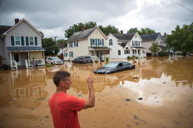 A evacuated resident, points towards his home in Helmetta, New Jersey following a flash flood caused by Tropical Storm Henri on