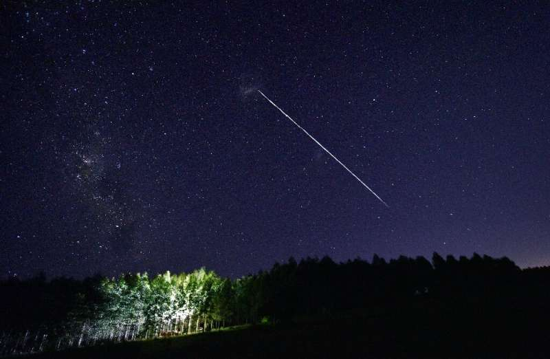 A long-exposure image shows a trail of a group of SpaceX's Starlink satellites passing over Uruguay—but will the company's batte  - a long exposure image - Competitor fears Musk's SpaceX could 'monopolise' space