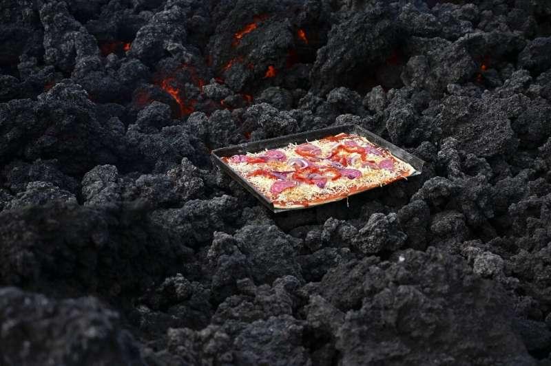 A pizza cooks on volcanic laza on the Pacaya volcano 25-kilometers south of Guatemala's capital