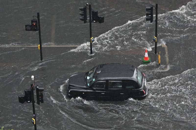A report saying climate change has made the UK warmer and wetter comes after flash flooding and a mini-heatwave in England last