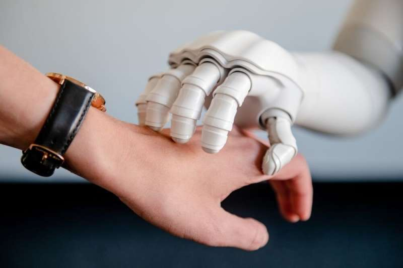 A touch from a conversing robot is linked to positive emotional state