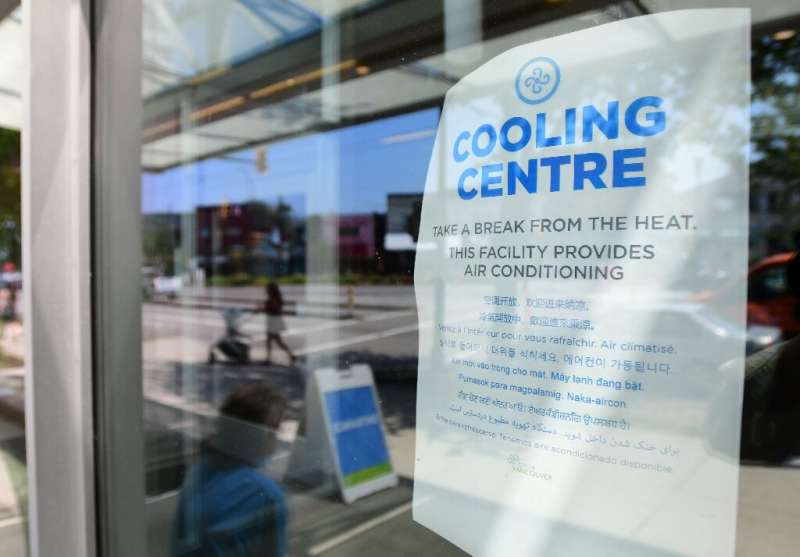 A welcoming sign is seen on the door of the Hillcrest Community Centre, where people can cool off during the extreme hot weather