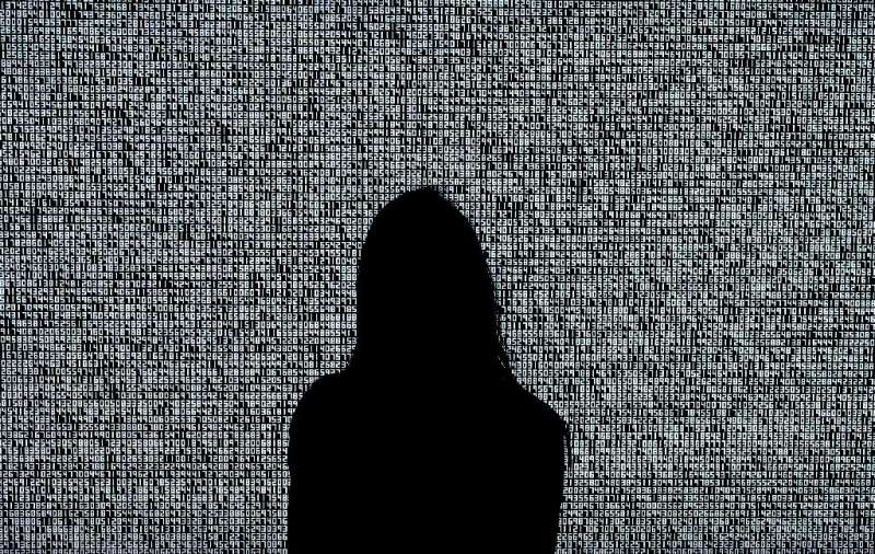 A woman looks at an NFT by Ryoji Ikeda titled 'A Single Number That Has 10,000,086 Digits' during a media preview at Sotheby's i