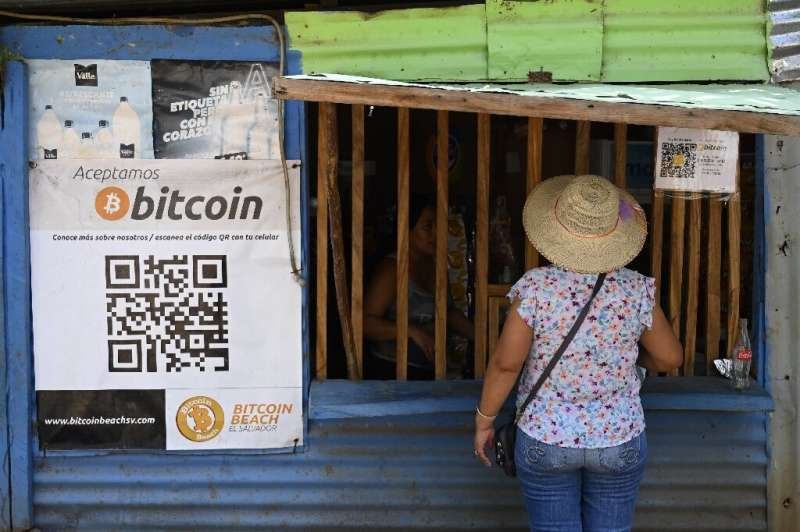 A woman shops in a store that accepts bitcoin in El Zonte, El Salvador, the first country to recognize the cryptocurrency as leg