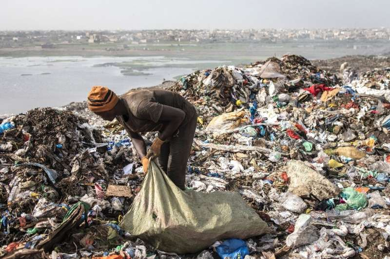 About 2,000 pickers ignore the stench and the fumes and make money by scavenging for plastic, iron and aluminium among the rubbi