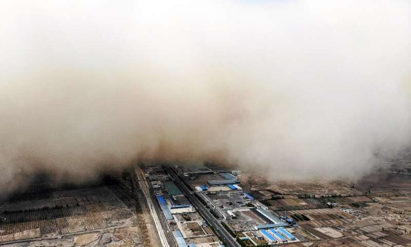 Aerial photos showed a sandstorm engulfing a village in Linze county, in the city of Zhangye in China's northwestern Gansu provi