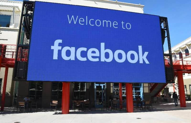A giant digital sign is seen at Facebook's corporate headquarters campus in Menlo Park, California, on October 23, 2019