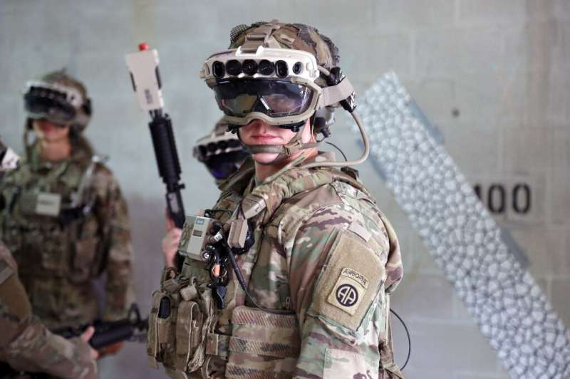 A head-mounted display used by soldiers for battle and training employs sensors for night and thermal vision in addition to prov