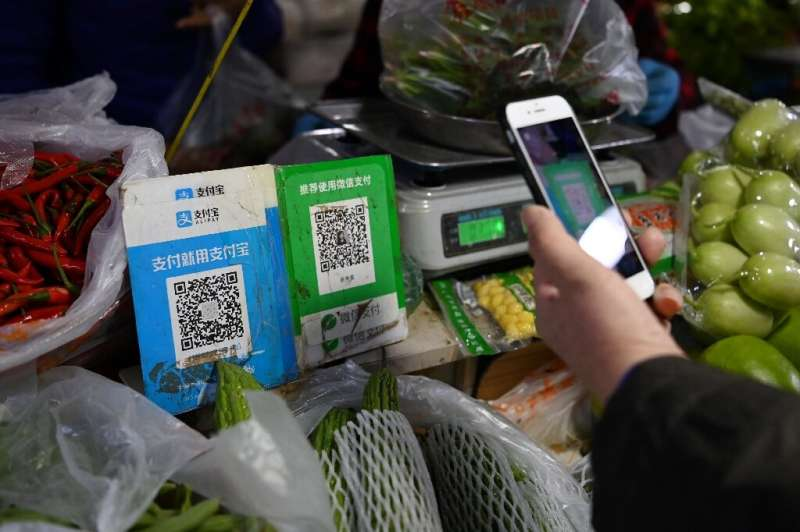 Alipay's app (QR code L) currently allows users to pay with a traditional credit card linked to their bank or offers small unsec