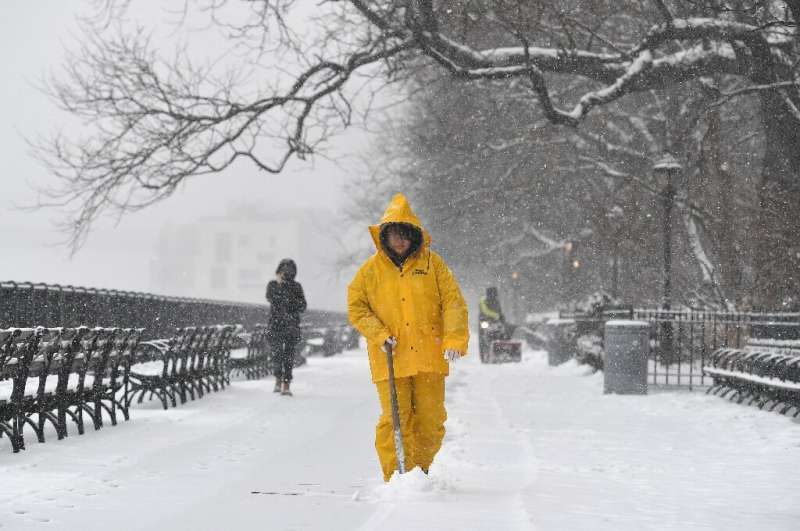 A man shovels snow in New York on February 18, 2021