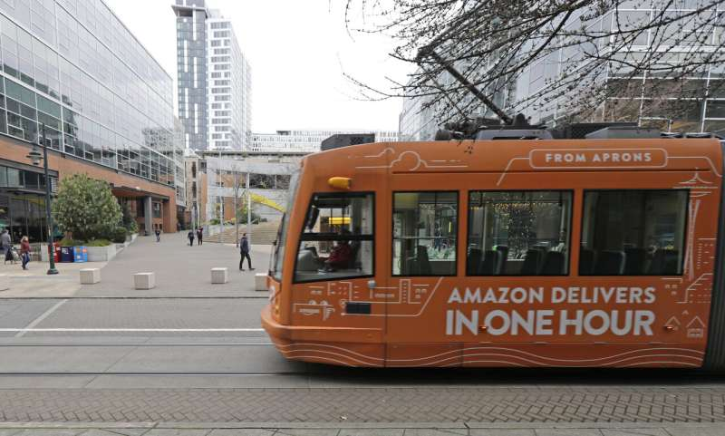 Amazon pushes back return to office to January due to COVID