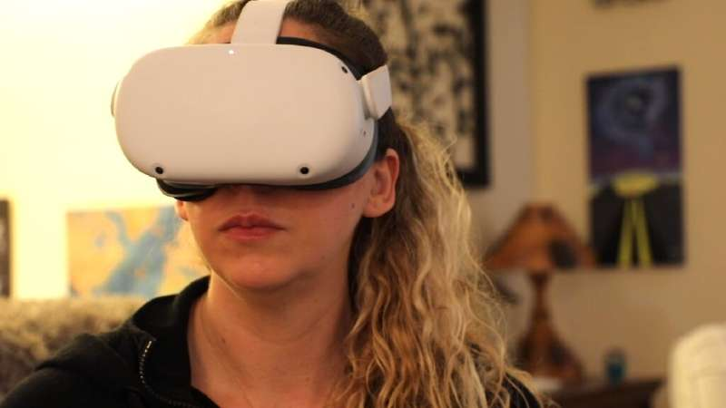 Amy Erdt,  seen with Oculus headset, on March 19, says virtual reality can help people experience travel and new destinations ev