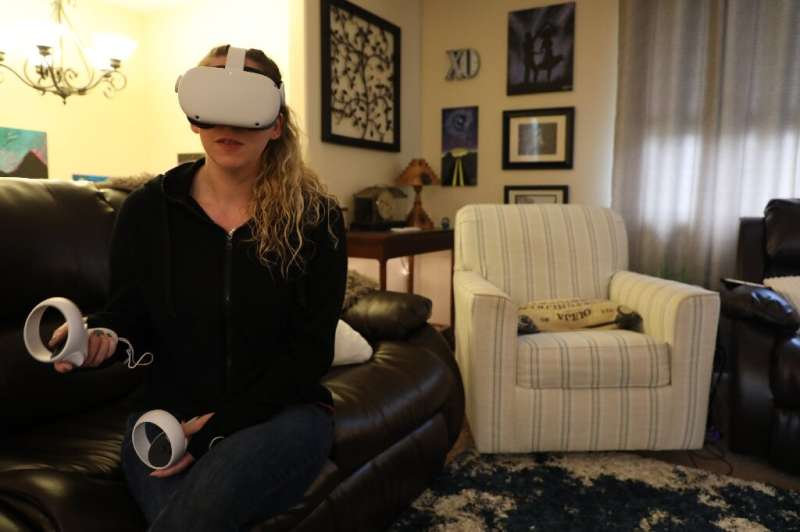 Amy Erdt, who manages a virtual reality Facebook group, sits in her living room in Oregon and travels to foreign cities virtuall