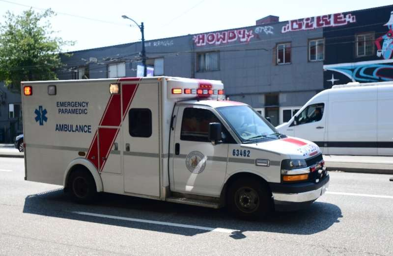 An ambulance is seen during the extreme hot weather in Vancouver, British Columbia, Canada