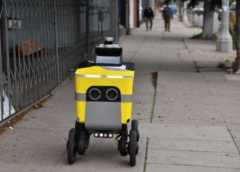 A Postmates robot brings food to customers in Los Angeles—the robotics division of Postmates, acquired by Uber last year, will b