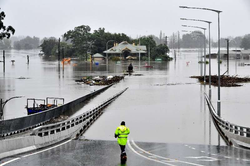 A rescue worker stands at the entrance to Windsor Bridge after the area was inundated with floods in the Windsor area in northwe