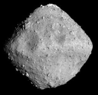 Asteroid sample brought back to Earth gets close-up look at Brown
