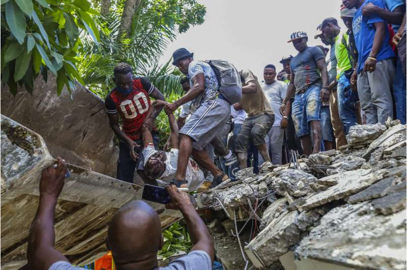 At least 304 dead, 1,800 hurt as powerful quake slams Haiti