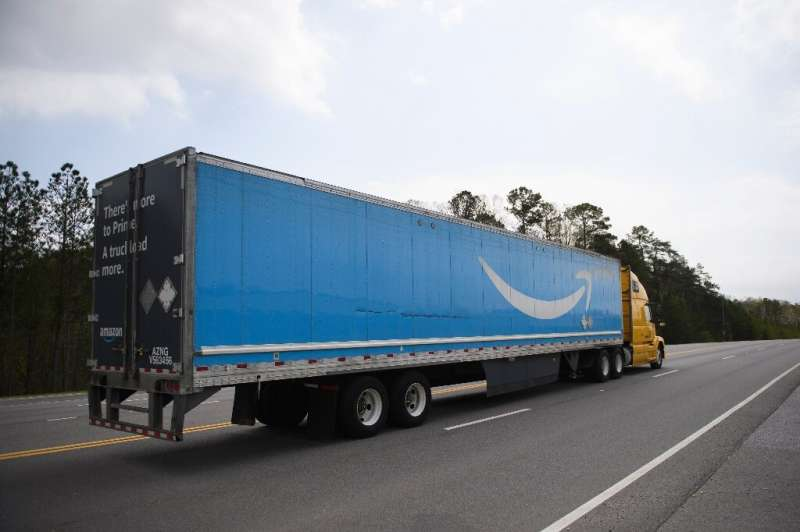 A truck bearing Amazon's logo is seen on a highway in the southern US state of Alabama on March 26, 2021