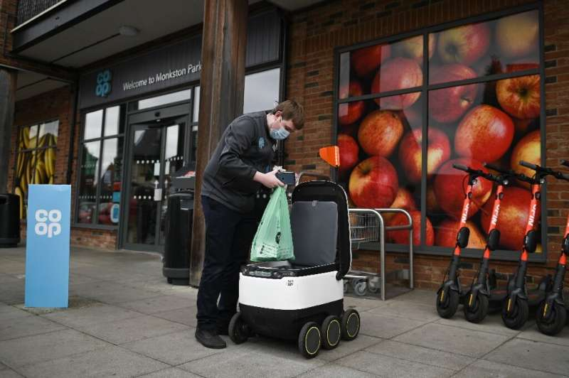 Bags of shopping are packed into the robot when an order is made