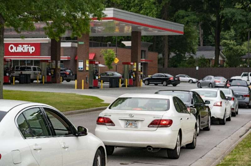Cars lined up at gas stations in the United States after fears of a fuel shortage following a major ransomware attack