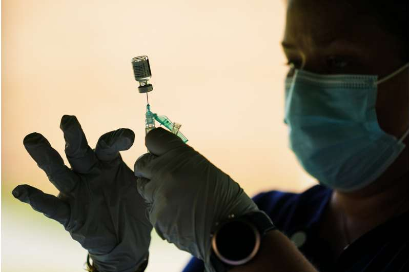 CDC panel tackles who needs booster shot of COVID vaccine