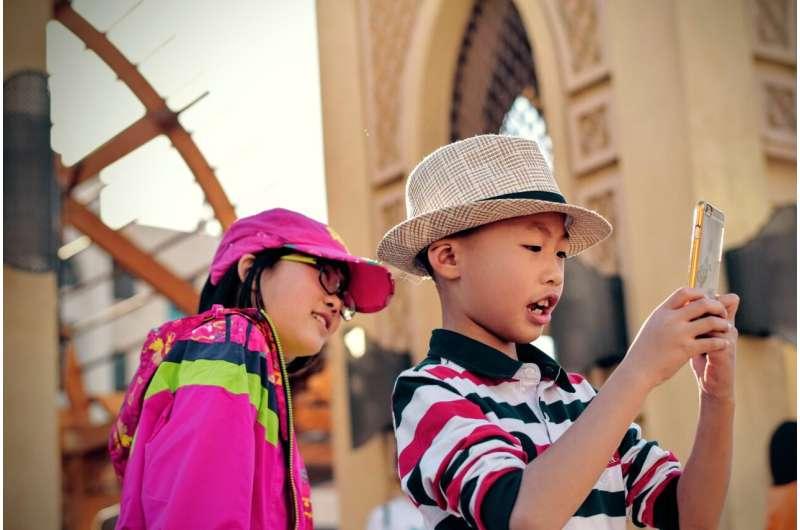 child using iphone